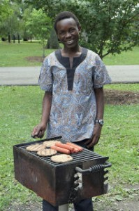 "Our grillmeister, Kevoh (Calvin) Nyapete, one of the very helpful ""volunteers"" who came with Jeff Cornelius"