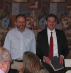 The traditional passing of the book and the gavel from outgoing to incoming chair. This year, Jeff Cornelius passes long to Eric Bruton. And ... it's ... complete! (Please forgive the motion blur.)